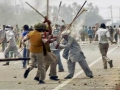 villagers attack police